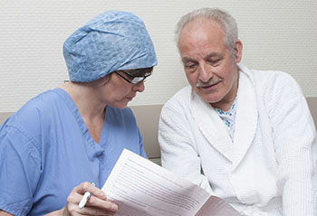 A surgeon informing a patient