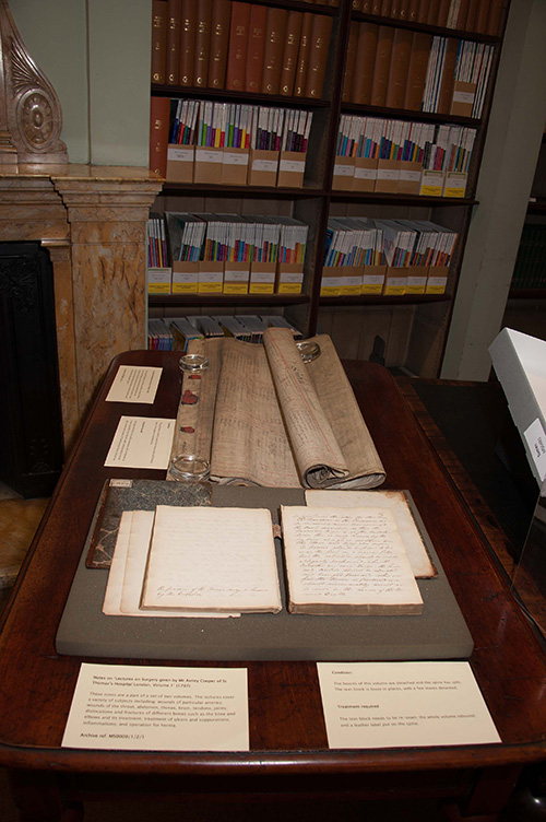 Books and manuscripts displayed on a table