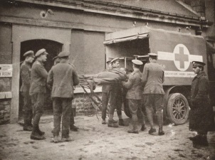 Loading an ambulance for evacuation